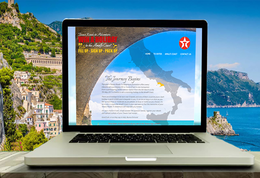 Amalfi coast background with computer screen featuring Texaco Sales Promotion by Brandfire
